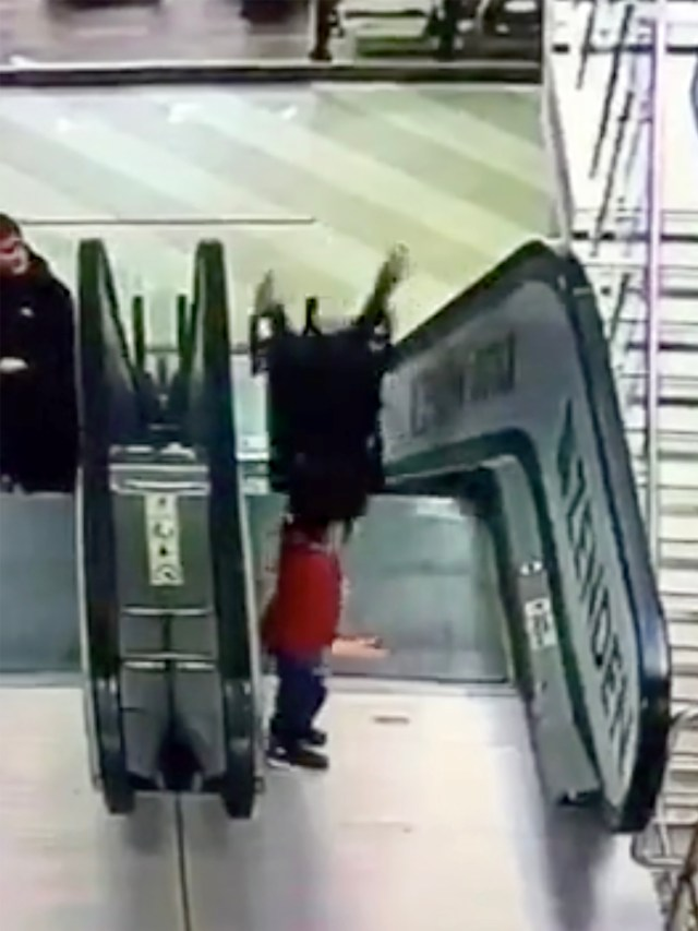 The girl is flipped head first onto the grinding steps of escalator