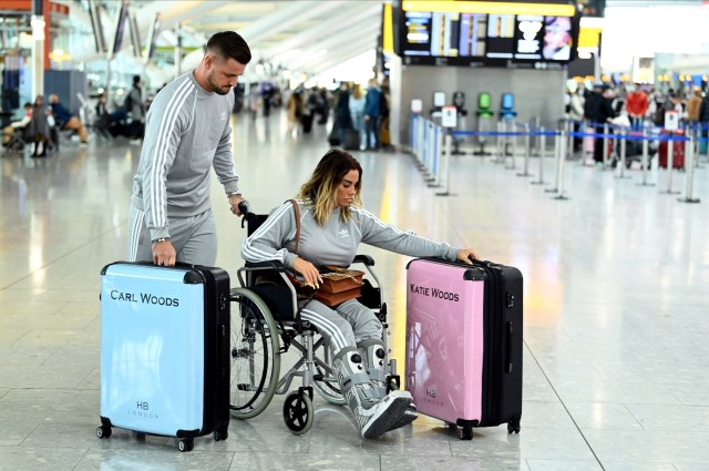 Carl pushed Katie through the airport in her wheelchair