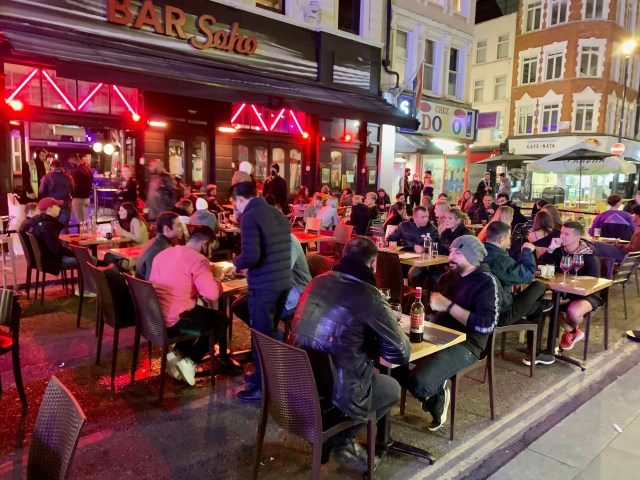 Crowds enjoy a drink in Soho on Sunday night