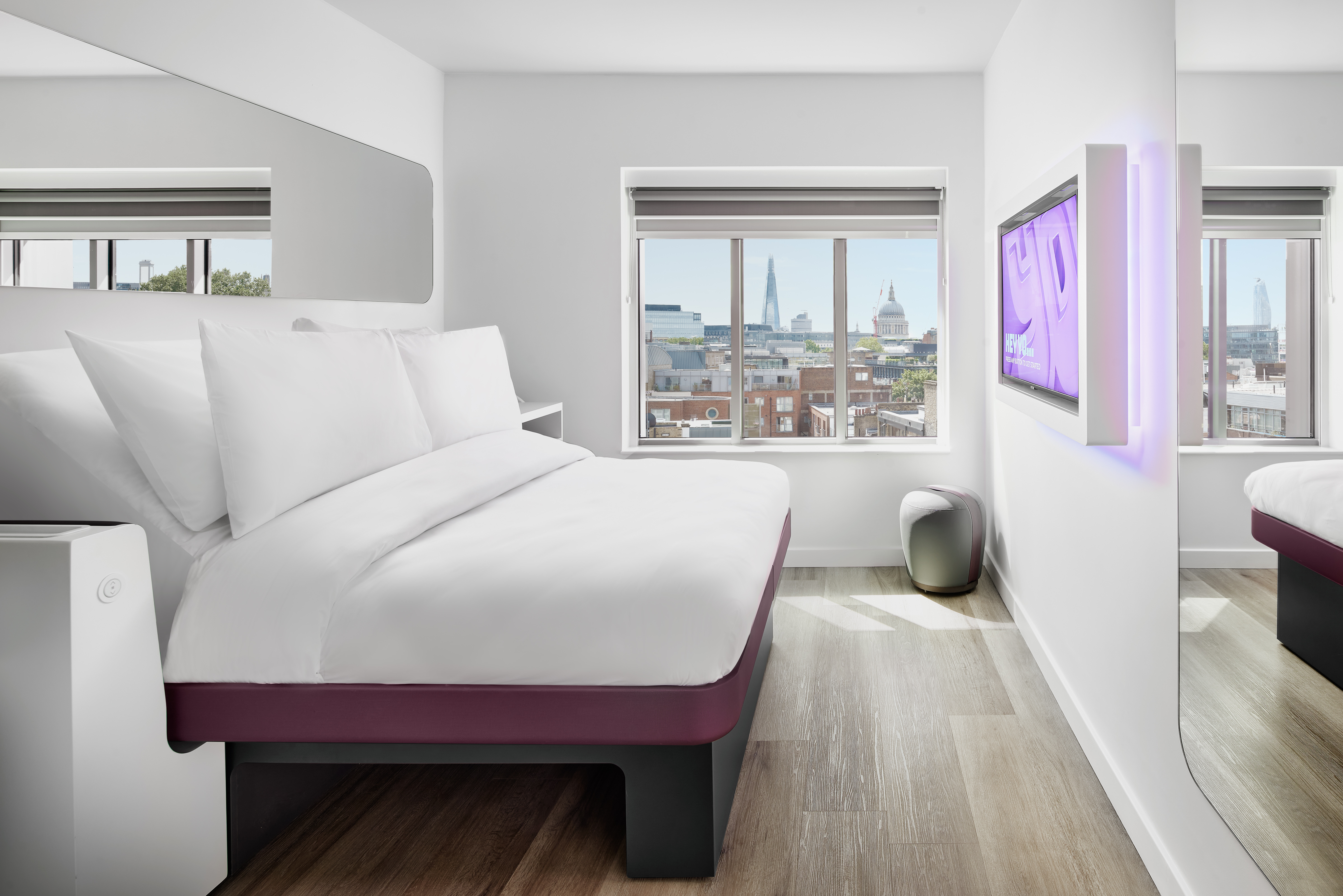 YOTEL's smart and compact cabins have adjustable beds, flatscreen TVs and rainfall showers in each bathroom