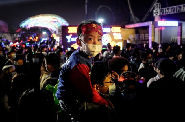 Only a handful of people wore masks during the elaborate celebrations