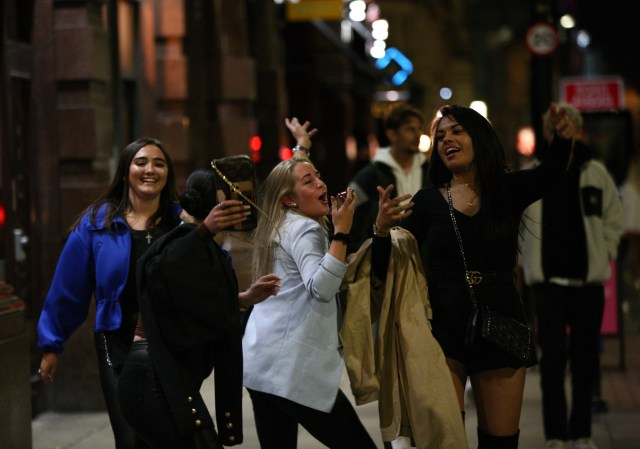 Friends enjoy a night out in Manchester while the city faces a Tier 3 lockdown