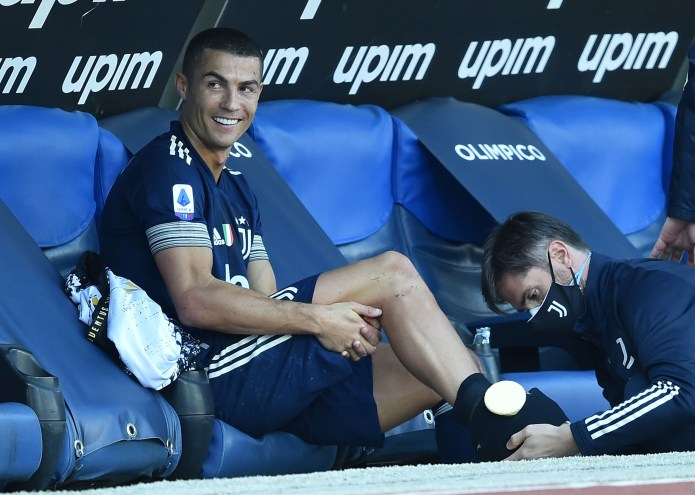 Cristiano Ronaldo had an ice pack on his ankle as he sat on the bench