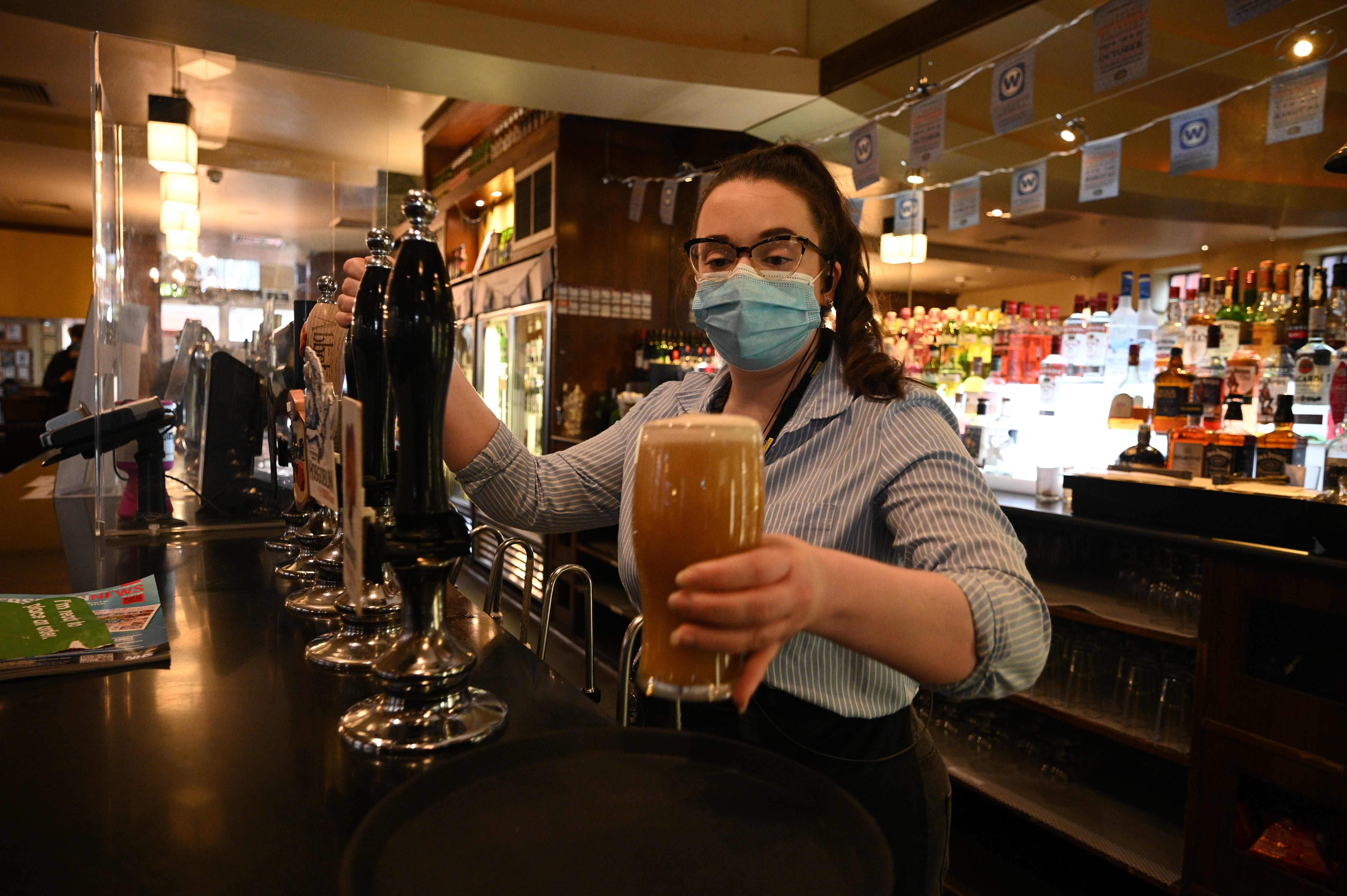 A member of the bar staff pulls a pint in a Wetherspoons pub in Leigh, Greater Manchester