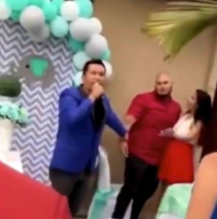 A horrifying video ha apparently captured the moment a husband 'exposed his wife's affair' during a baby shower