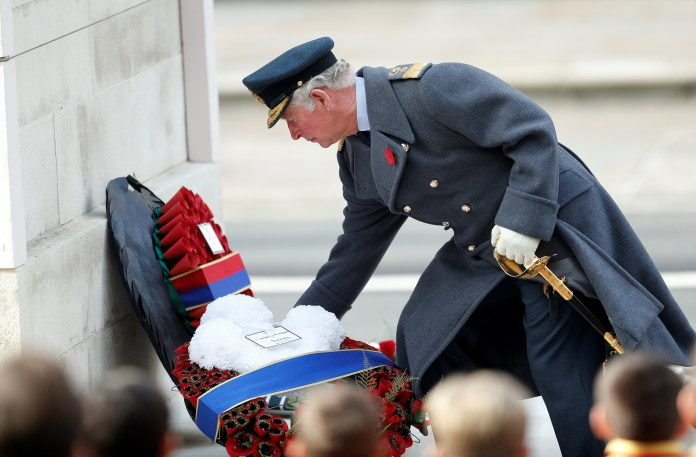 Prince Charles lays a wreath at the cenotaph yesterday