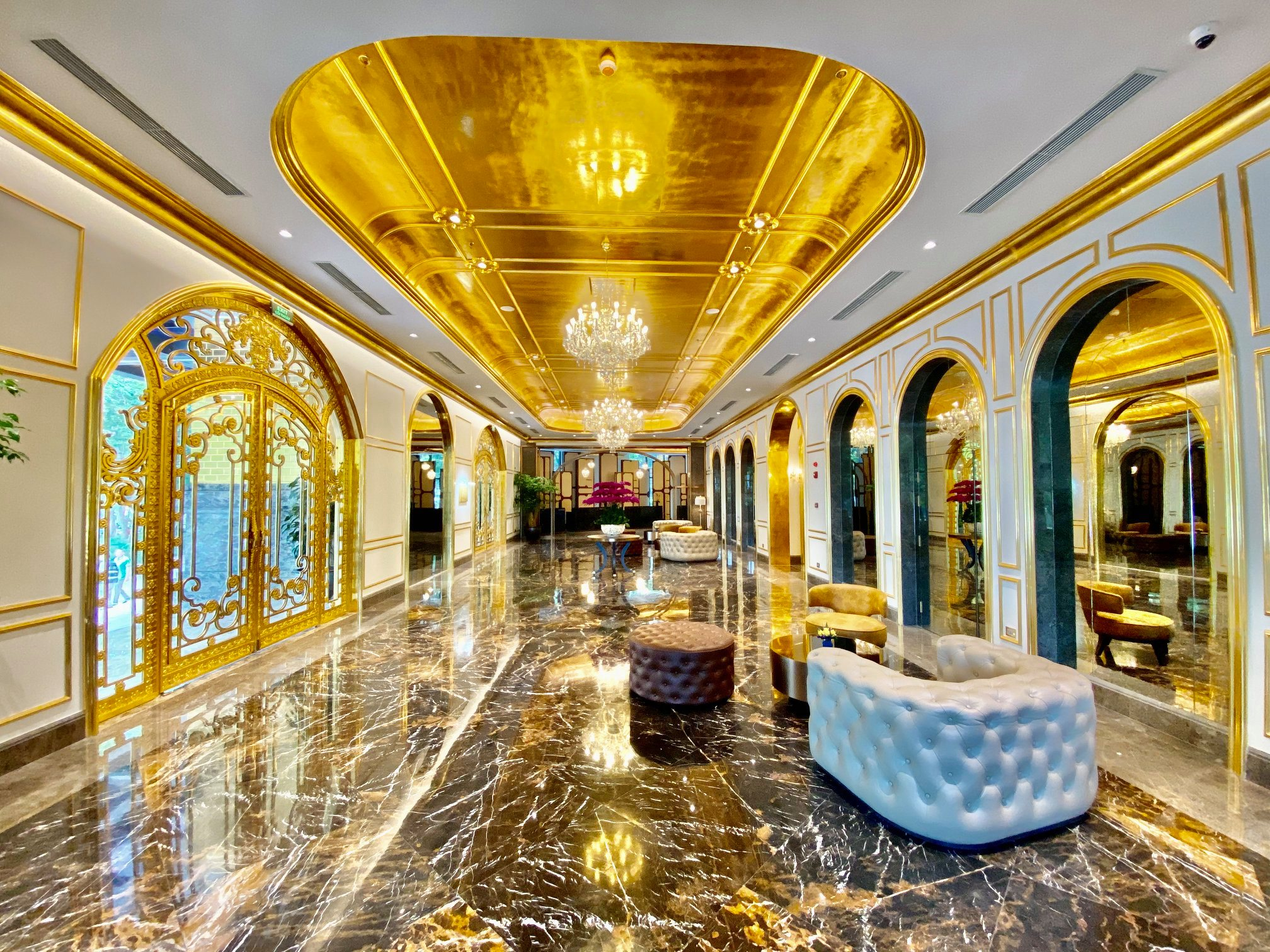 The decadent hotel is fitted out with fancy gold-themed interiors