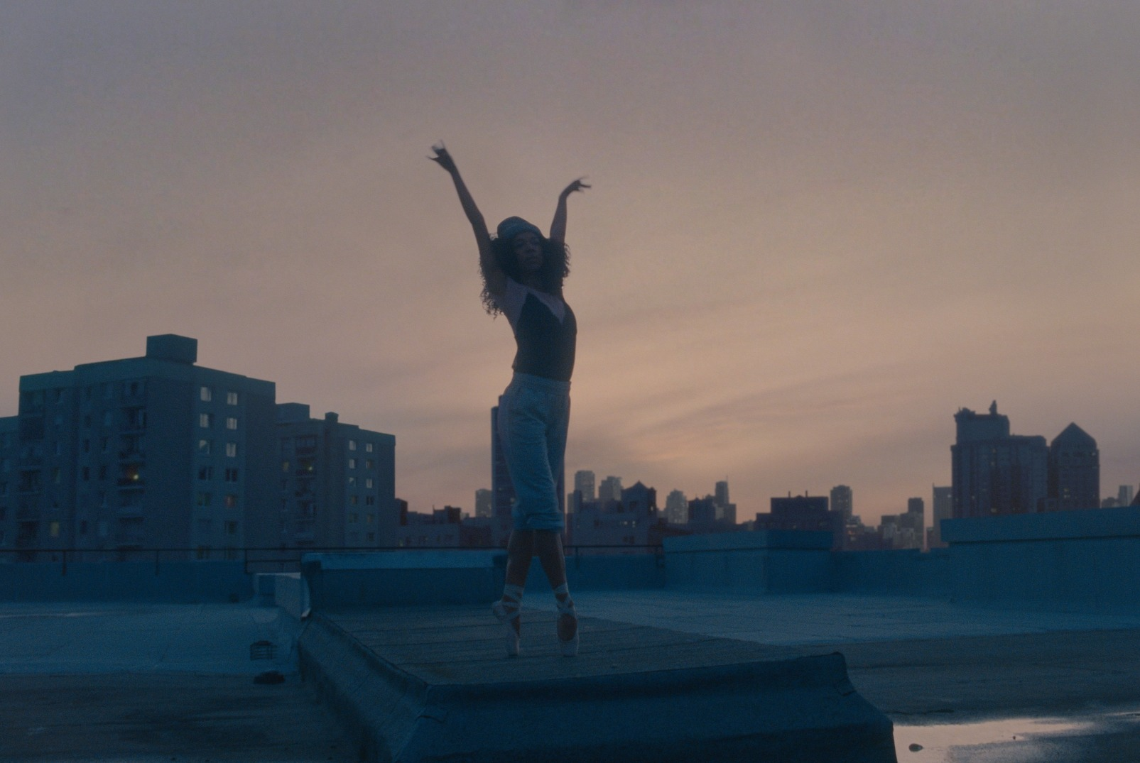 As the ballet school closes due to coronavirus, the dancer carries on training around her neighbourhood