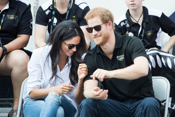 Meghan and Harry at their first public appearance together watching wheelchair tennis at the Invictus Games 2017 in Toronto, Canada