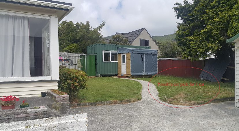 The container is located in someone's back garden
