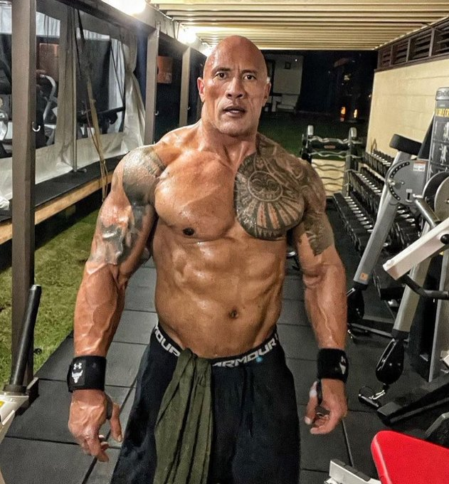 The Rock had phenomenal shape as he posed in the gym