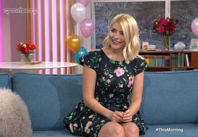 She celebrated by drinking champagne and tucking into cakes on the show