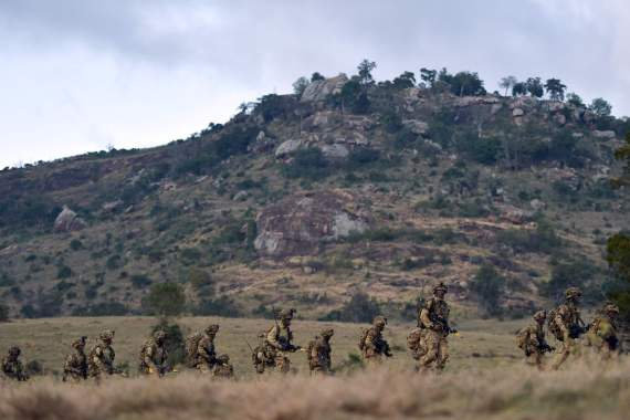 A company of soldiers troop during a simulated military exercise of the British Army Training Unit in Kenya (file image)