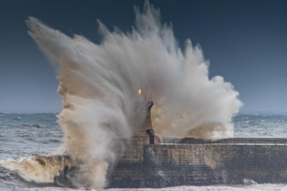 Huge waves break over South Shields Pier in Tyne and Wear