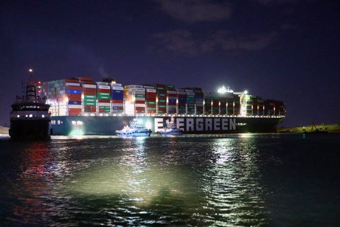 Rescue vessels work at the site of the stuck container ship Ever Givenlast night