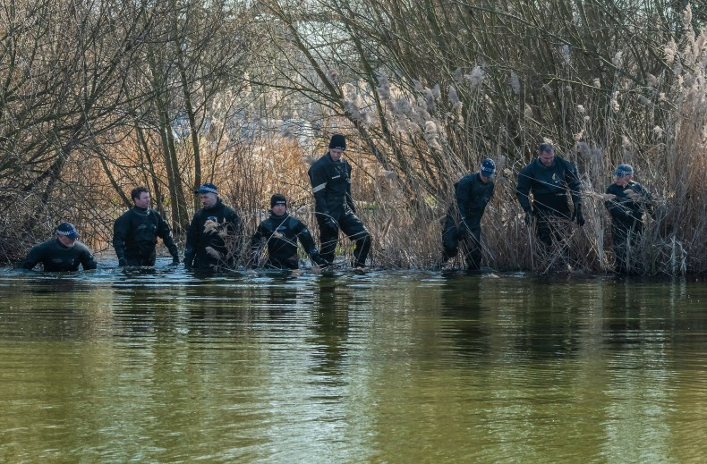 Police searching the Mount Pond in Clapham Common