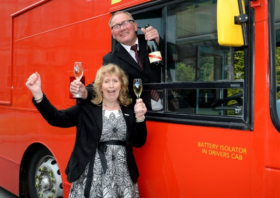 Bus driver Kevin and wife Michelle break out the bubbly - but only after Kevin went into work