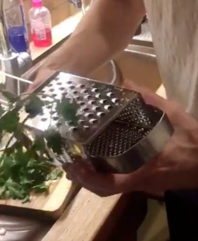 The mum showed how to use a cheese grater to easily seperate herbs without have to pick them off
