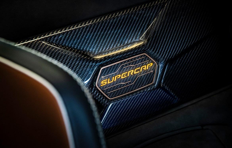 The glow-up 'supercap' badge between the seats