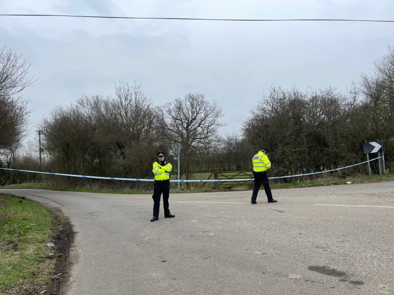 Officers stand guard as the investigation into Sarah's disappearance continues