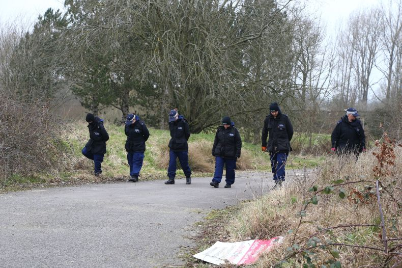 Officers from the Metropolitan Police conduct a search at Great Chart Golf and Leisure near Ashford, Kent