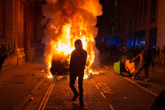 Protesters set fire to a police van during the protests on Sunday night
