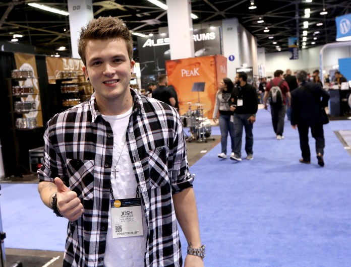 One Direction's Josh Devine is teaching the F1 star how to play the instrument