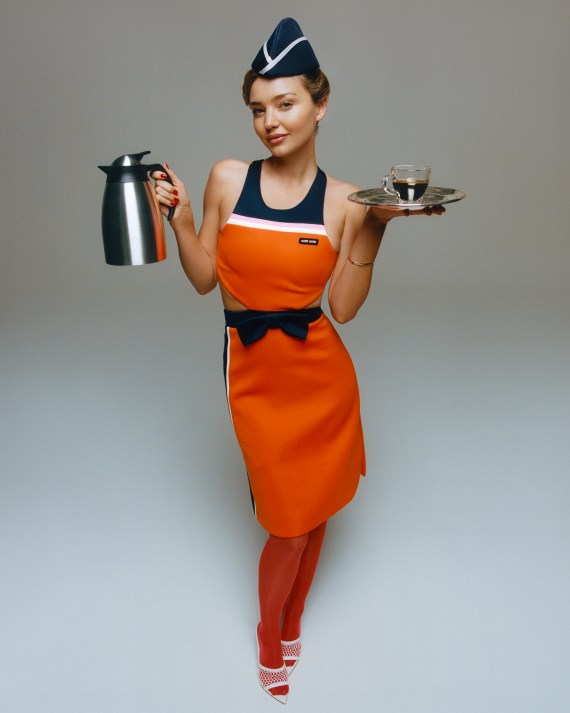 Miranda Kerr, 37, wore the blue hat and orange dress uniform as she posed for a fashion shoot