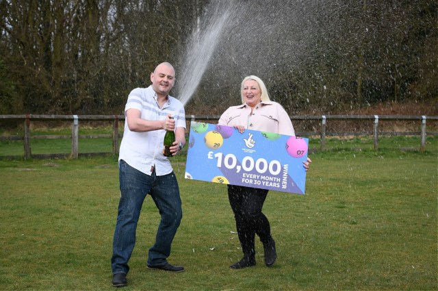 The couple celebrate their lotto win - saying it now meant they were able to follow their dreams