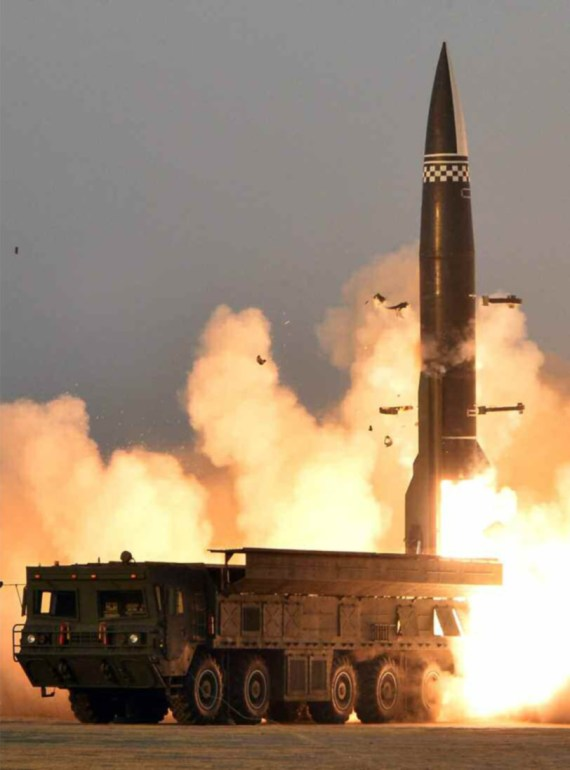 Pictures show North Korea's missile test yesterday