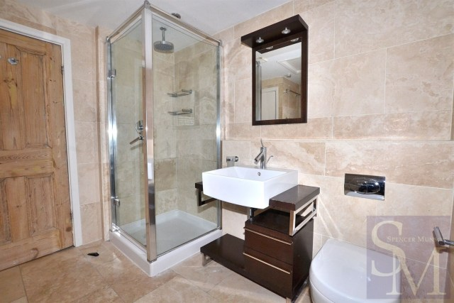 The bathroom features a shower and tub