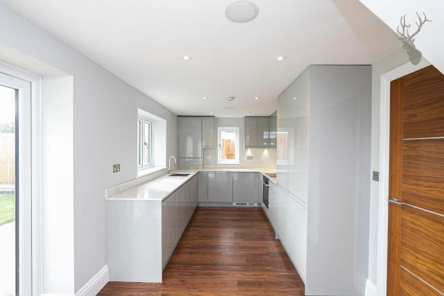 The crisp white walls are a perfect blank canvas