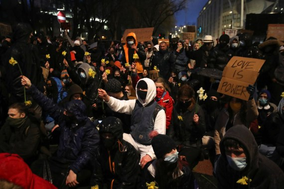 Many protesters held daffodils and chanted 'peaceful protest'