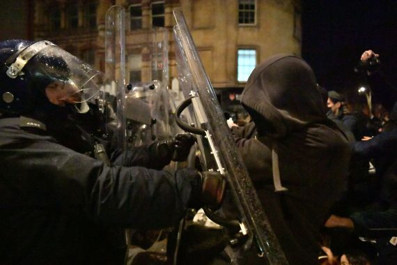 Police officers move in on demonstrators in Bridewell Street
