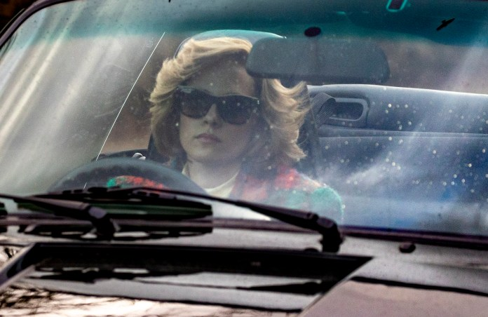 Sporting the Princess of Wales' trademark hair, Kristen was seen driving her vintage supercar