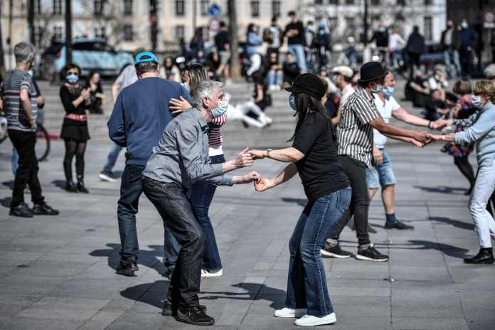 People danced hand-in-hand outside the Arab World Institute