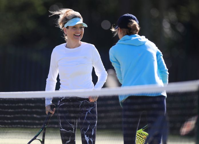 Two tennis players talked during a game of doubles at Grantham Tennis Club