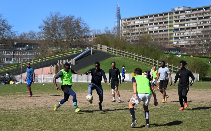 A small group played football in a park in London