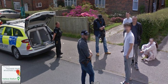 Armed cops can be seen standing outside of a house on Google Maps