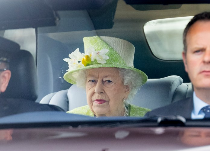 The Queen leaves Windsor Castle on her way to the RAF memorial in Runnymede, Surrey