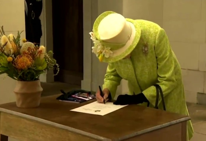 She signed a commemorative document before departing the event