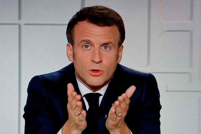 """French president Emmanuel Macron warned in a televised address his country is likely to """"lose control"""" amid soaring Covid rates"""