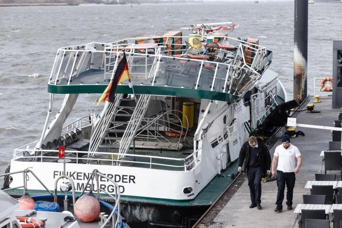 The monster ship smashed into a small ferry in Hamburg injuring one person