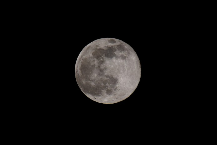 The moon - pictured from Kent - is known as the 'true sign of spring'
