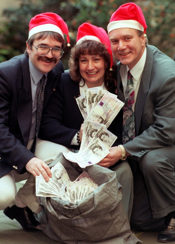 Elaine with husband Derek, left, and brother Ian, right - she gave Ian £1million of her win