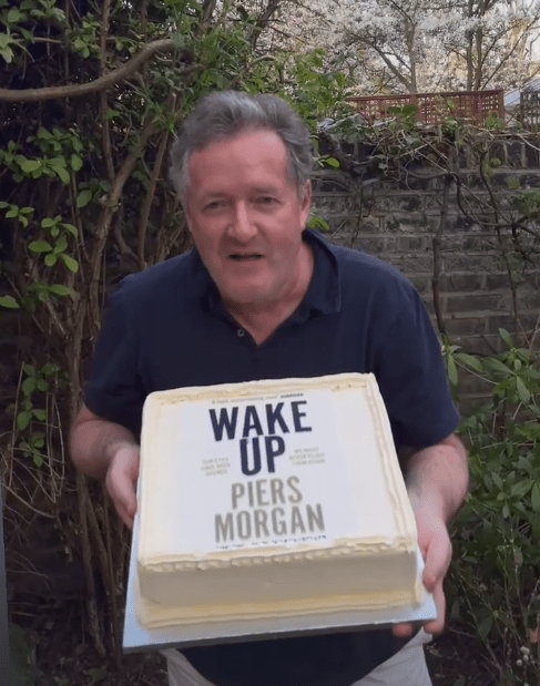 Piers got a birthday surprise as he posed with his cake