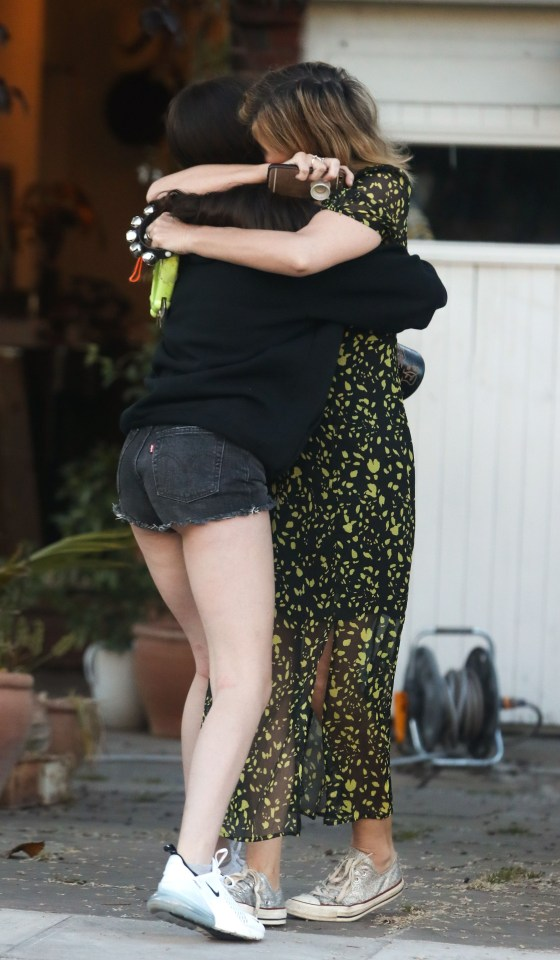 The star seen hugging her daughter Darcey at one of the emotional 8pm 'claps'