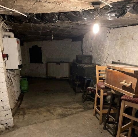 The pub's cellar has hidden coffins in various sizes