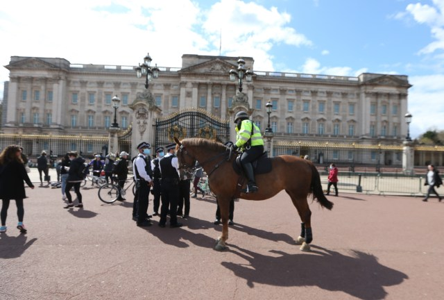 Police outside the Palace as people were told to stay away