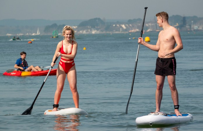 Paddleboarders make the most of the hot weather in Sandbanks
